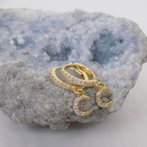 crescent moon huggies dainty hoop earrings gold